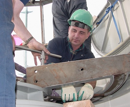 Cullen assisting with reassembly of the Heceta Head Lighthouse lens.